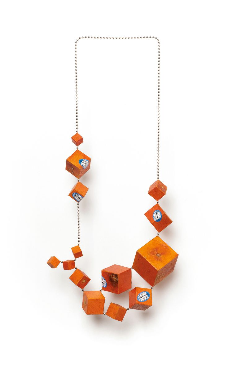 "Cubic Tangelo Necklace I , 2015. Tangelo peel, plywood, steel. 15.75"" x 8"" x 2.25"""