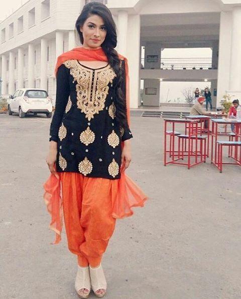 Black and orange suit