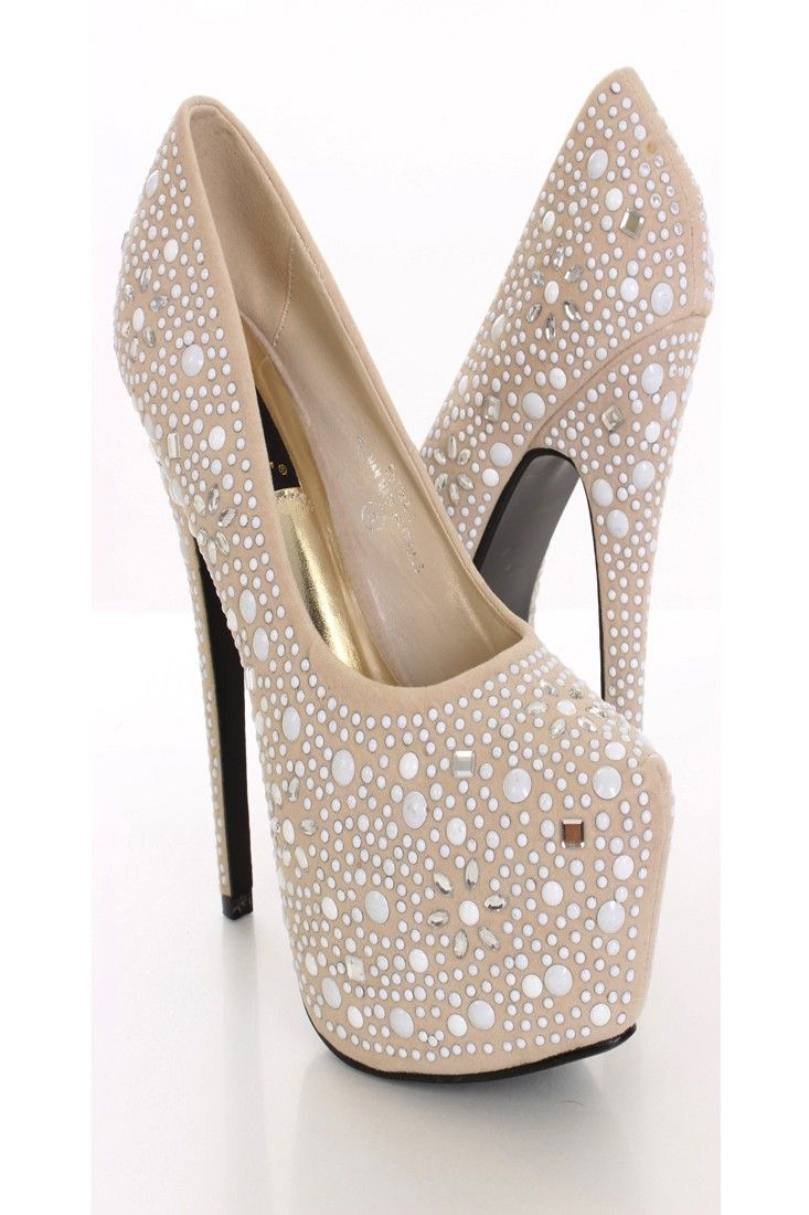 Add glamour and sparkle to any outfit with these sexy heels! They will look super hot paired with your favorite skinnies or dress. Make sure you add these to your closet, it definitely is a must have! The features include a faux suede upper in a pump design, studded and gemstone detailing throughout, stitched almond shaped closed toe, scoop vamp, smooth lining, and cushioned footbed. Approximately 6 1/2 inch heels and 2 1/4 inch hidden platforms.