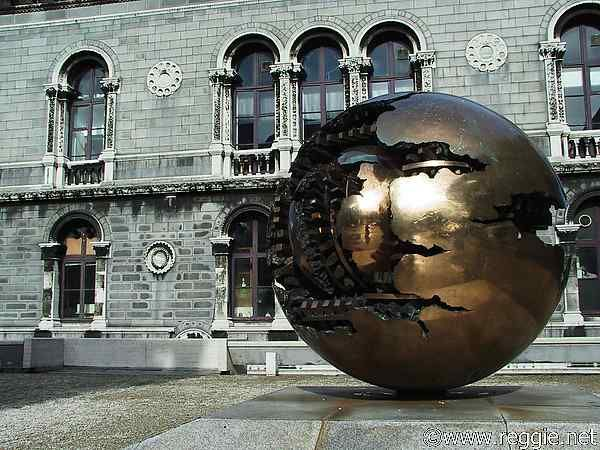 "Arnaldo Pomodoro sculpture ""Sphere with Sphere"" by museum, Trinity College, Dublin, Ireland, photo"