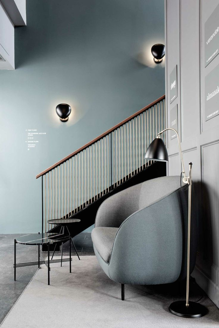 An interior from the Palace Hotel Copenhagen: Cobra wall fixtures by Greta Magnusson-Grossman (1950) and the Beslite floor lamp by Robert Du...