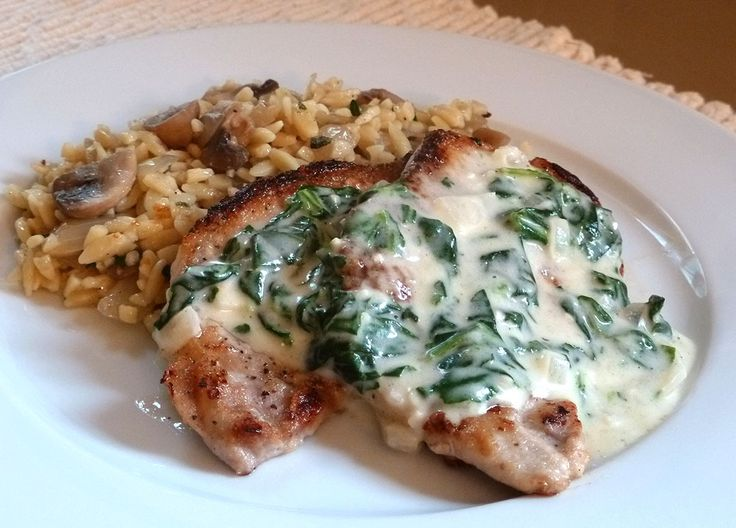 Pork Florentine ... pan-fried boneless pork chops in a creamy spinach sauce 6 oz of baby spinach leaves, chopped into large pieces 1 lb of thinly sliced boneless pork chops (about 4 to 5 chops) 4 tablespoons of flour, divided ½ of a white onion, diced 2 cloves of garlic, minced 1 cup of chicken broth ½ cup of heavy cream 1 cup of grated Parmesan-Reggiano Salt and pepper Garlic powder Olive oil