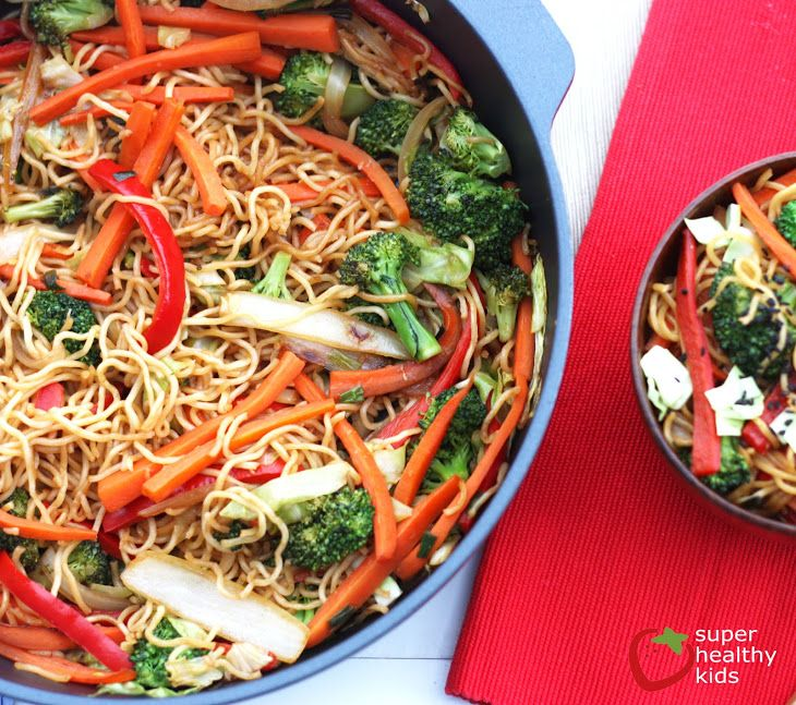 One Pot Veggie Yakisoba Recipe Main Dishes with cabbage, carrots, red bell pepper, onions, green onions, broccoli florets, soba noodles, soy sauce, rice vinegar, rice wine, ginger root, garlic cloves