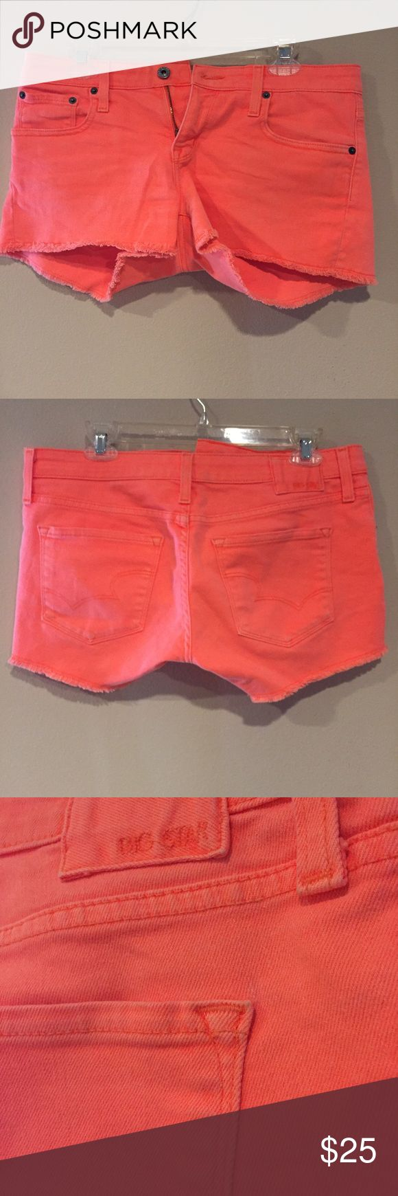 Big Star | Distressed Hot Orange Jean Short These bright orange shorts are so fun and look great on sun kissed skin in summer! Super comfortable with a little stretch. Big Star Shorts Jean Shorts