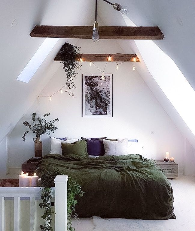 Open wood beams, white walls, charcoal bedding
