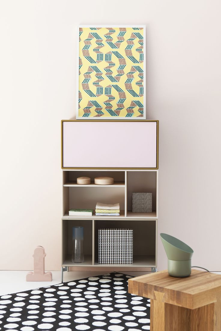 See how a simple bookcase can get an impressive design look with the use of only one framed quirky print, some sophisticated accessories and a playful carpet. The colour combination is pretty awesome too.