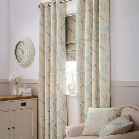 Patterned with birds and leaves in a duck egg blue tone over a textured natural base, these ready made curtains feature a linen blend for enhanced softness, ful...