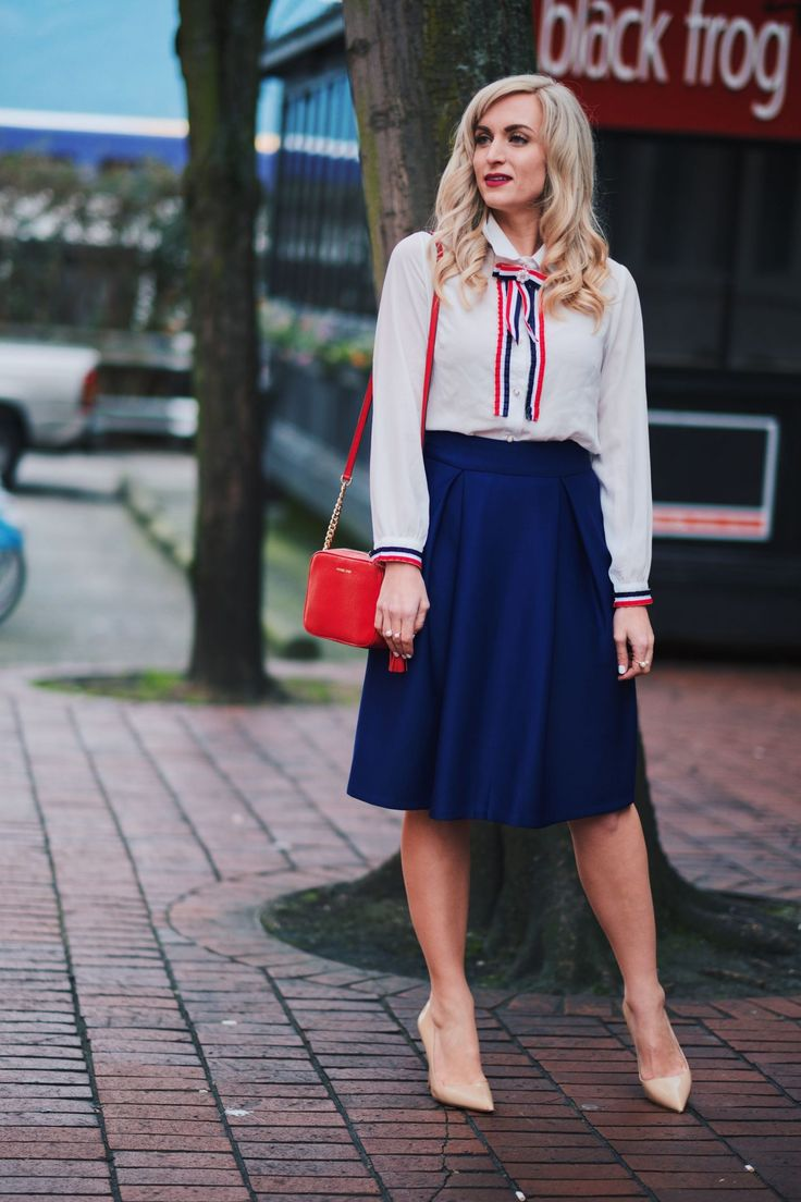 Red, white and blue for a feminine but professional business casual look! This bow and ribbon embellished blouse is under $20 and the midi skirt is under $25!