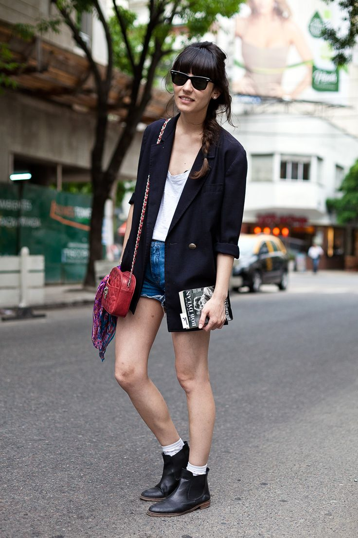 On the corner in Buenos Aires... Daniela rockin some short shorts, a blazer and boots. Totally works.