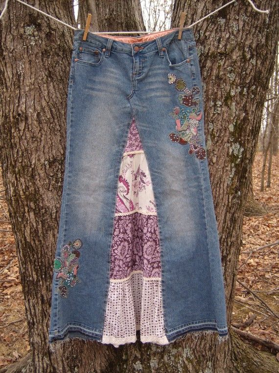 This Chic skirt is up-cycled from a pair of embroidered Zana Di Jeans. embroidery is in pinks and blues with white pearl beads scattered within.