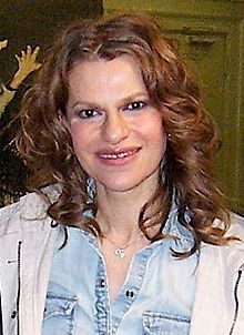 Sandra Bernhard. She was born in Flint, Michigan, the daughter of Jeanette and Jerome Bernhard. She has three older brothers. Her family moved to Scottsdale, Arizona, when she was 10. After graduating from Saguaro High School in Scottsdale, Arizona, she went to live and volunteer on a kibbutz in Israel. She moved to Los Angeles at the age of 19. During that time she paid her bills by working as a manicurist in a high-end salon.