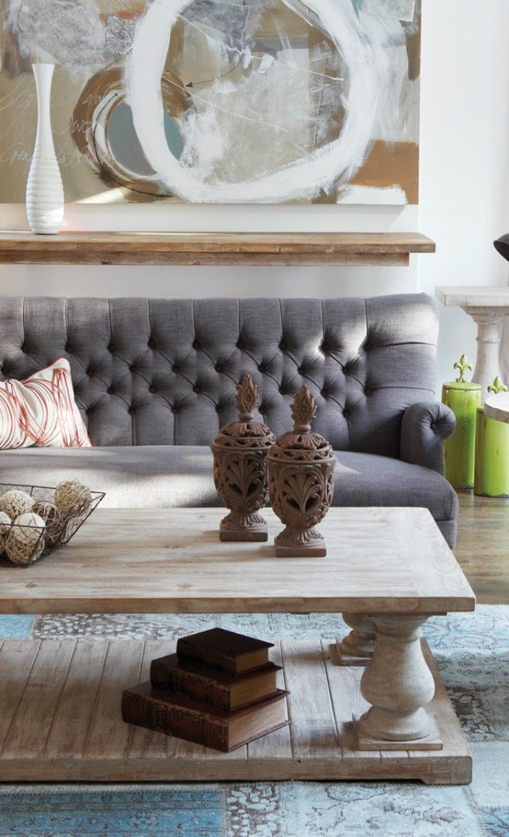 Tufted grey couch, neutral tones and textures.
