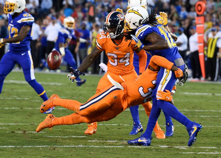 Broncos vs. Chargers:   October 13, 2016  -  21-13, Chargers   -       Denver Broncos cornerback Kayvon Webster (36) hits San Diego Chargers wide receiver Travis Benjamin (12) on a punt as Denver Broncos defensive back Will Parks (34) grabs the loose ball during the second quarter October 13, 2016 at Paul Brown Stadium. The ball hit Benjamin on the leg resulting in live ball recovered by the Broncos.