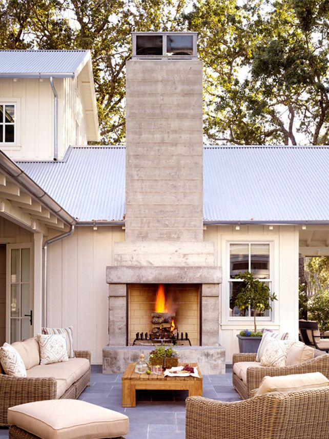 Patio with outdoor fireplace. Great patio with outdoor fireplace. It would be great to roast marshmallows or talk to some friends here. I love the relaxed yet stylish feel of this patio. Floors are bluestone. #Patio #OutdoorFireplace