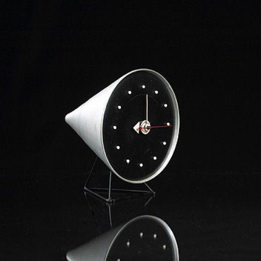 GEORGE NELSON &ASSOCIATES  Cone table clock, model#2218  Howard Miller ClockCompany USA , 1954