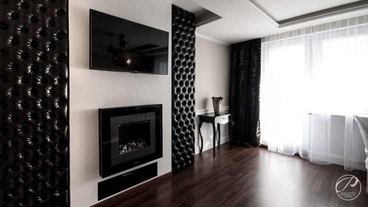 Apartament w Łomiankach  Salon w kolorze czarnym i białym. Progetti Architektura