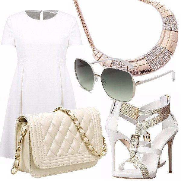 Protagonista di questo outfit l'abito bianco, perfetto nella sua semplicità! Modello a girocollo, di linea leggermente svasata con manica corta. Sandalo bianco alto impreziosito da brillantini. Piccola borsa trapuntata color nude con catenella dorata. Collier in metallo dorato con strass. Completano il look grandi occhiali da sole con montatura bianca.