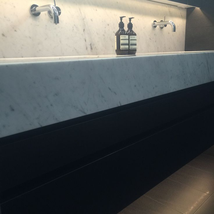Bianco Carrara marble tops, black Lappato floor tile from Bisanna Italy, black fine grain cabinetry