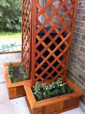 Lonestar Cedar Planters set up in a clever way to hide a garbage can.