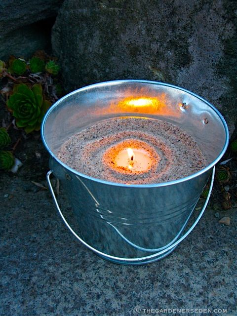 Quick, Inexpensive and Lovely. Tin Buckets filled with Tiny, Twinkling Tea Lights (Set of 12 Galvanized Tin Buckets – $18.99 at Amazon)