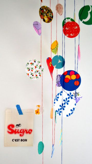 colorful paper mobile... Definitely easiest to make which is appealing given time frame +quantity required! Could be pretty& effective in right colors. Could be circles or squares / diamonds