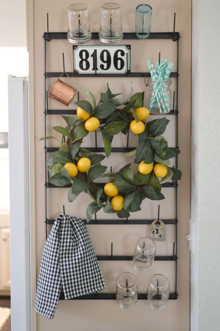 Cottage Kitchen with vintage style Farmhouse bottle drying rack, lemon wreath, paper straws, old bar jar and French yogurt glass collection.