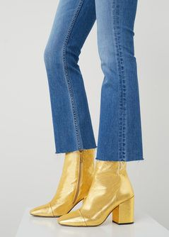 SHOP: I'm seeing metallic leather boots all over the place this season and they're a great way to add interest to a plainer outfit. This gold pair from Mango is pretty reasonable.