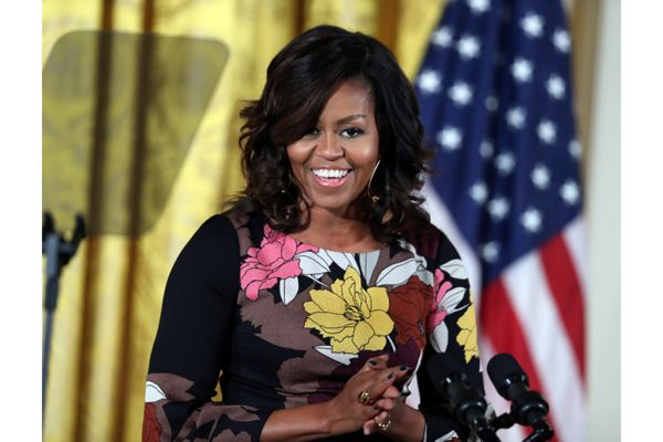 Many in a small town in West Virginia have been calling for the resignation of both a nonprofit group's director and the town's mayor, after the two were connected with a Facebook post about Michelle Obama that is seen as blatantly racist.
