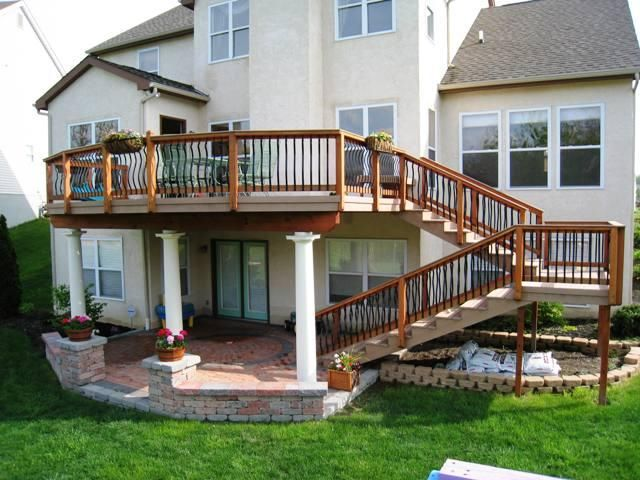 Raised Deck With A Turning Staircase And Large Landing. Love The Patio  Underneath.