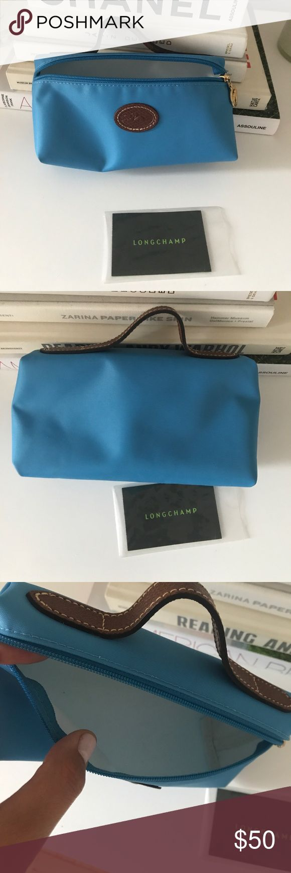 NWT Longchamp small makeup bag Longchamp small makeup bag, NWT! I also have a light pink one (with a small stain) listed in my Poshmark closet too! Longchamp Bags Cosmetic Bags & Cases