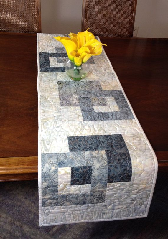 Modern Batik Table Runner, Handmade Grey Quilted Tablerunner, Gray Wallhanging, Reversible Table Quilt. Contemporary Dining Room Decor ----------------------------------------- Although designed as a modern look table runner, this quilt could also be used to adorn your wall, a dresser, coffee table, sofa table, buffet, desk, bed or piano top. The grey color scheme is versatile and can be used in any season. A layer of batting enclosed between two layers of cotton fabrics gives extra…