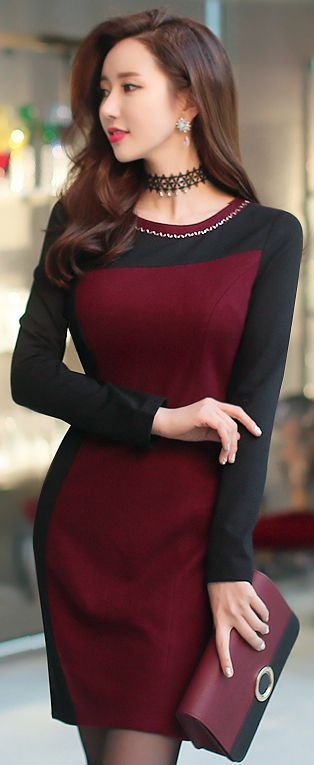I'm not usually a fan of colorblocking, but I like it here, probably because the burgundy is so dark that it keeps the contrast low.  I also like the asymmetry of the bodice.  I'd prefer 3/4 length sleeves, as always.