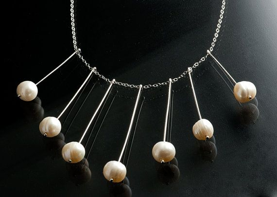 Fresh Water Pearls on sterling silver wire hanging from
