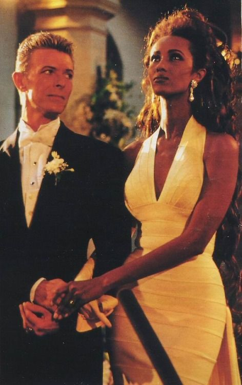 Bowie in his wedding tuxedo by Thierry Mugler. Iman in Herve Leger #epic #wedding
