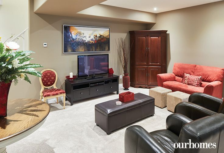 """The basement family room doubles as a guest sitting room when company comes.    See more of this home in """"She Loved this Chandelier and Built a House to Suit It"""" from OUR HOMES Wellington County Orangeville Caledon, Summer 2017: http://www.ourhomes.ca/articles/build/article/she-loved-this-chandelier-and-built-a-house-to-suit-it"""
