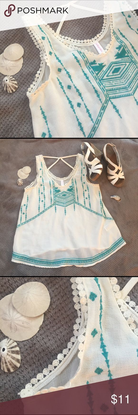 Aztec Print Tank Top Very cute and flattering white Aztec print top. Fun strappy back. Semi-sheer, not too see-through. The stitching is like a dark aqua. Gently used, no damage. Xhilaration Tops Tank Tops