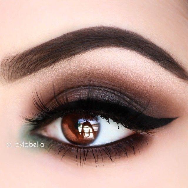 Dark brown eyeshadow with matte forest green on inner...