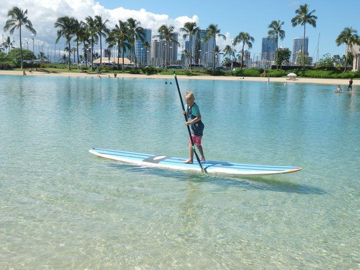 Paddle boarding in the Lagoon at the Hilton Hawaiian Village, Honolulu, Hawaii, USA