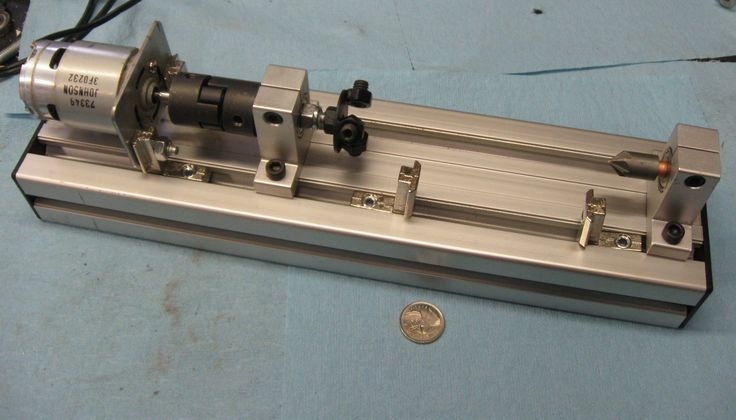Mini Metal Lathe by Random_Canadian -- Homemade mini metal lathe adapted from repurposed power tools and small parts. Features precision speed control and incorporates a 3-jaw chuck and a 2-axis tool holder. http://www.homemadetools.net/homemade-mini-metal-lathe