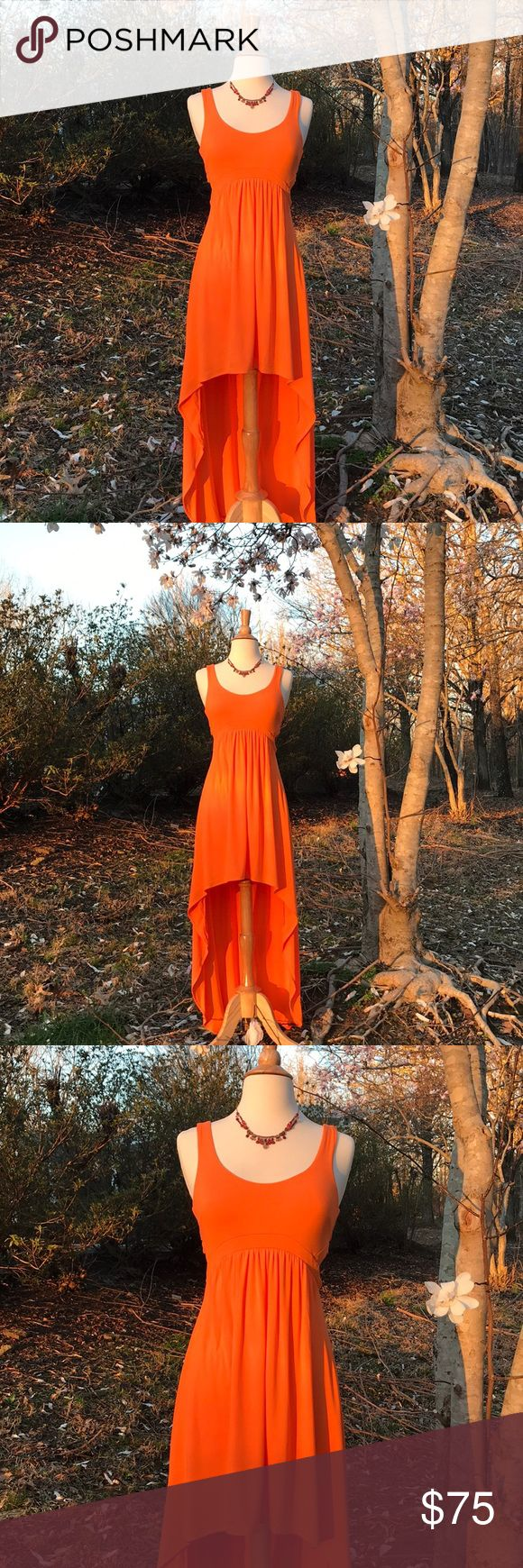 """🍑BEBE HIGH LOW CUT OUT WAIST AND BACK DRESS🍑 🍑BEBE HIGH LOW CUT OUT WAIST AND BACK DRESS!🍑. Perfect condition. Size Small Petite. Fabulous dress!!  Pretty bright orange. Sexy cut out at sides of waist and back. 15"""" armpit to armpit. 55"""" from top of shoulder to bottom of back. 25"""" from center front neckline to bottom of front hi-lo. Fabric has stretch. 93% Rayon 7% Spandex. You will love this dress!🍑🎉 🌼BUNDLE ITEMS AND PAY SHIPPING ONCE 🌼 💛HAPPY POSHING 💛 🍑ORDERS ARRIVE GIFT…"""