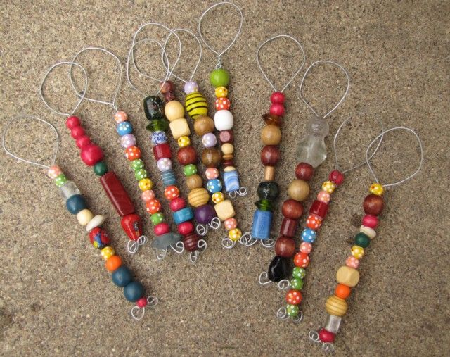 Bubble wands for blowing bubbles, made with wire and beads.