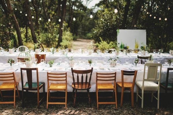 Mismatched wooden chairs for a garden reception. Photo by LakshalPerera.com