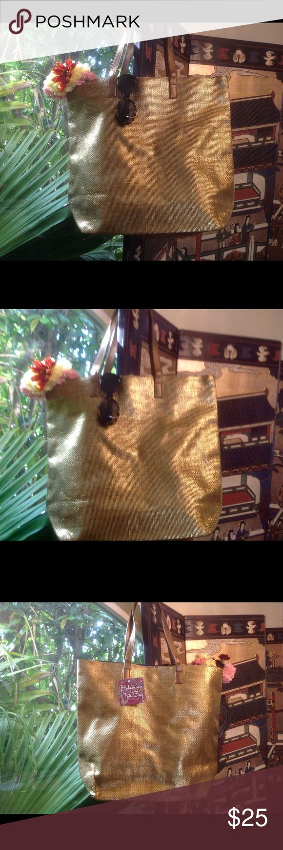 """Large gold tote bag ❤️ Beautiful large gold tote bag! ❤️ Perfect bag to put in all your beach necessities!👙☀️🎉💐🍧Fully lined with purple lining! ❤️ Inside pocket with zipper! ❤️ Brand new! ❤️ Dimensions: 17.5X15X5.5 inches with 2 handles 20"""" each! ❤️ Priced to sell! ❤️ Bohemian Tote Bags Totes"""