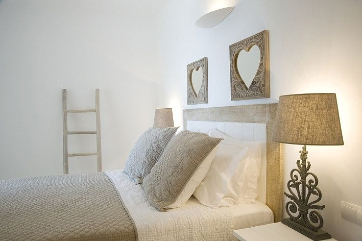 I love the calming taupe/tan and white.  The ornate hearts are beautiful. (Lose the ladder.) Maybe add a little soft green and a tiny pop of red.