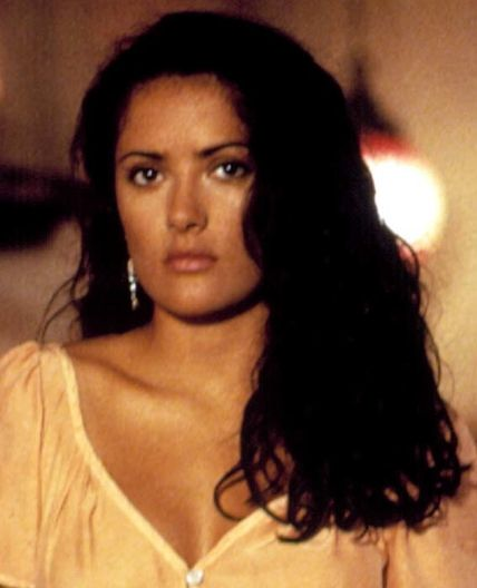 Salma Hayek in Desperado This is a #girlboss—a bookstore owner who can walk away from a burning building and thwart assassins with her soft spirals still in perfect condition.