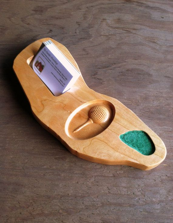 This is a great looking business card holder for the golf lover. Whether you are a golfer, golf trainer, pro shop employee, golf fan you will love this wooden business card holder! The card holder will be an eye-catching addition to your office desk or home work area. The golf ball is three dimensional with great detail carved in the wood. The gold course business card holder also has its very own felt green!  The wooden business card holder measures approximately 4 wide x 11 long and is…
