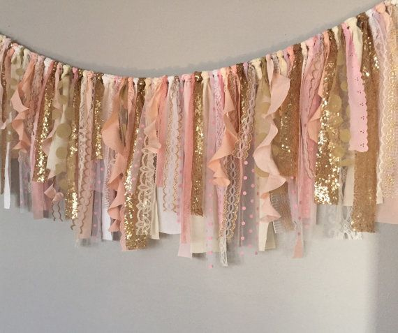 Pink fabric garland banner is made up of pink, white, ivory, and cream fabric, lace, and gold sequin. Torn and rag tied - edges are meant to fray.