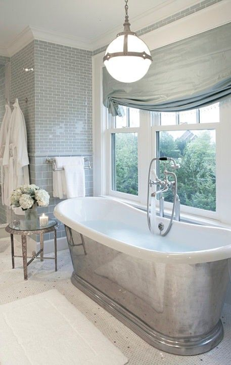 love the freestanding bathtub and cool white and silver colors in this bathroom