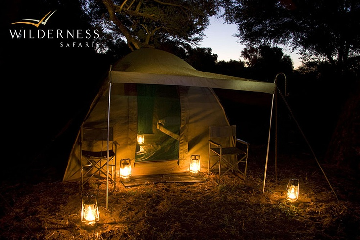 Pafuri Walking Trail - At night, lanterns and a crackling fire light the camp and create a convivial atmosphere with a light eco-footprint; guests dine under the stars. #Safari #Africa #SouthAfrica #WildernessSafaris