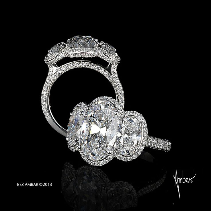 This Trio engagement ring has three Oval cut diamonds with pave frame and a shank set with micro-pave diamonds in 8 karat white gold.